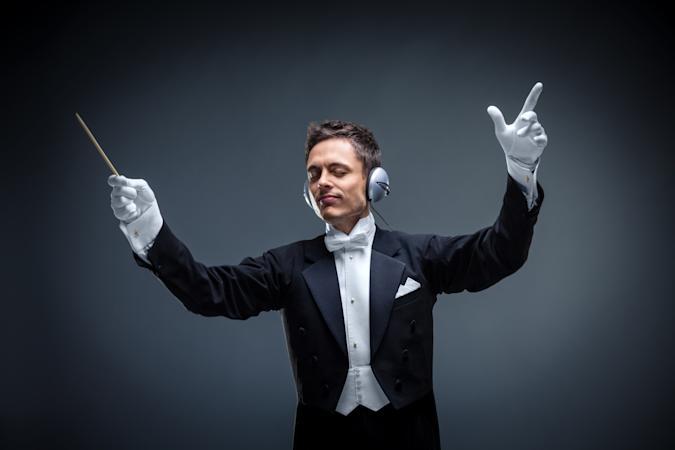 Conductor with headphones in studio