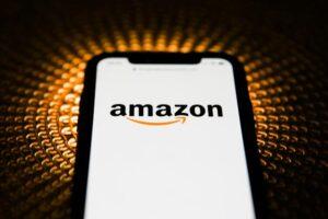 Amazon logo is seen displayed on phone screen in this illustration photo taken in Poland on February 20, 2020. (Photo illustration byJakub Porzycki/NurPhoto via Getty Images)